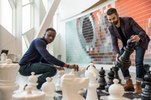 building strong culture - two men playing life-size chess
