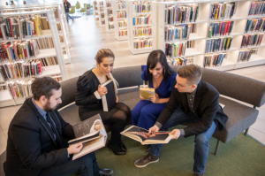 building strong culture - four people sitting around sharing books